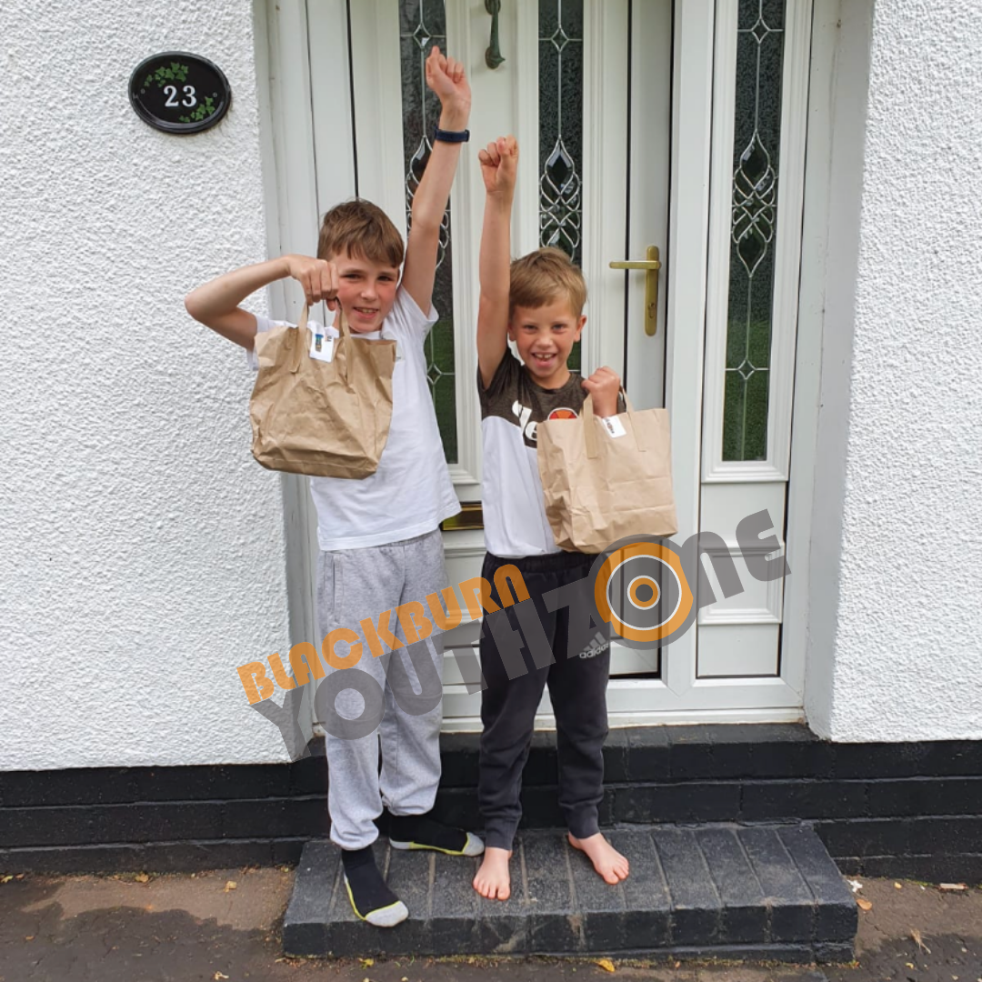 Junior members with their lunch and activity pack deliveries