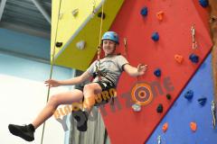 Senior member enjoying rock climbing